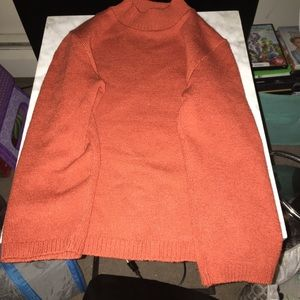 Size L Juniors orange mock neck sweater
